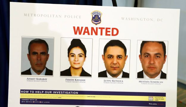 Pictures of people facing criminal charges are seen after a news conference in Washington, Thursday, June 15, 2017