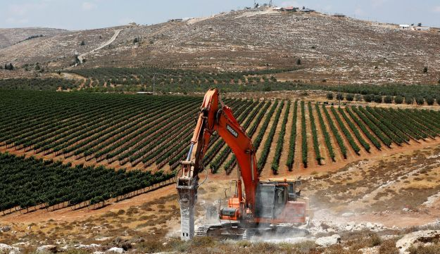 Heavy machinery work on a field as they begin construction work of Amichai, a new settlement which will house some 300 Jewish settlers evicted in February from the illegal West Bank settlement of Amona, in the West Bank June 20, 2017.