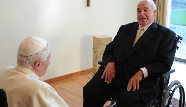 This file photo taken on September 24, 2011 shows Pope Benedict XVI with Kohl during a seminary in Freiburg, southern Germany, on the third day of the Pontiff's first state visit to his native Germany.