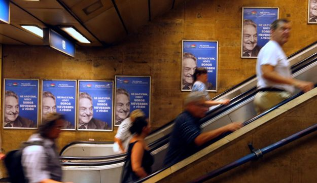 "Hungarian government poster portraying financier George Soros and saying ""Let's not let George Soros have the last laugh"" is seen at a subway station in Budapest, July 11, 2017."