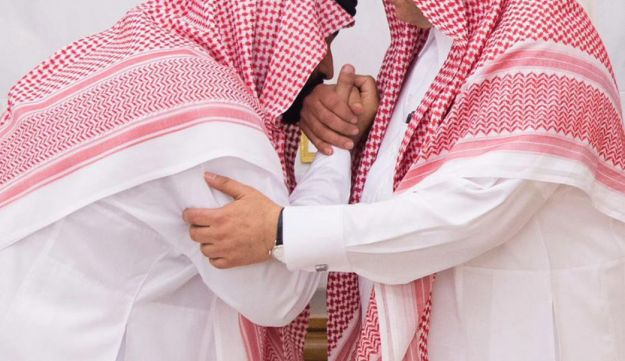 Mohammed bin Salman, newly appointed as crown prince, left, kisses the hand of Prince Mohammed bin Nayef
