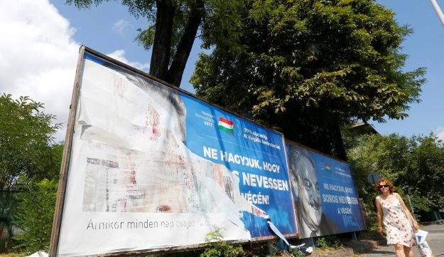 "The Hungarian government poster portraying financier George Soros and saying ""Let's not let George Soros have the last laugh"" is seen in the street in Budapest, July 11, 2017."