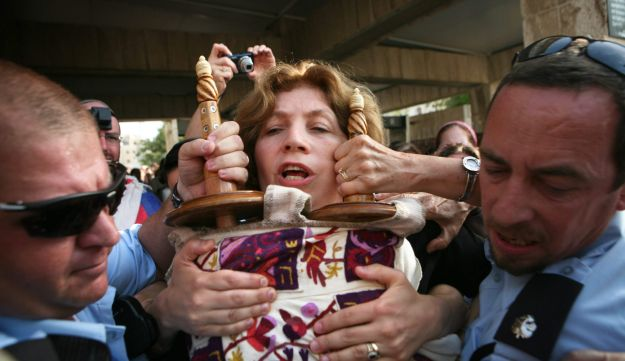 Head of Women of the Wall, Anat Hoffman, being arrested for bring a Torah scroll to the Western Wall. 12 July 2010
