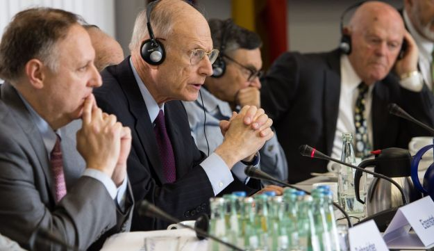 Claims Conference Executive VP Greg Schneider (L) beside Ambassador Stuart Eizenstat during negotiations with the German government in July.