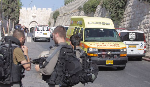 Emergency personnel at the site of the shooting attack in Jerusalem's Old City, July 14, 2017.