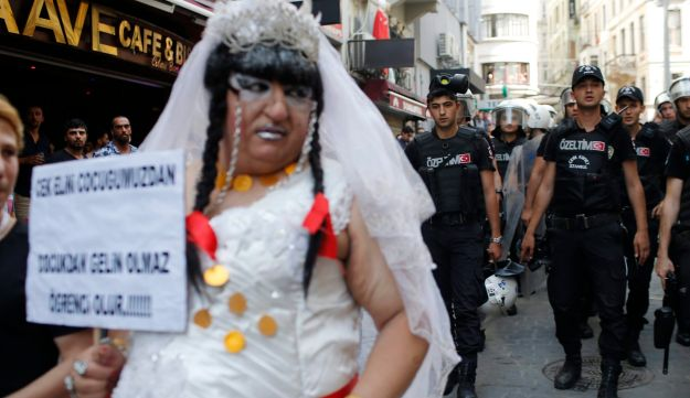 Turkish police walk as they push back participants of a gay pride event in Istanbul, June 28, 2015.