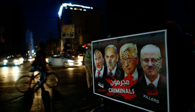 A poster showing footprinted portraits of Israeli Defense Minister Avigdor Lieberman, Israeli PM Benjamin Netanyahu, Palestinian President Mahmoud Abbas and Palestinian PM Rami Hamdallah during a protest against the blockade on Gaza. July 14, 2017.
