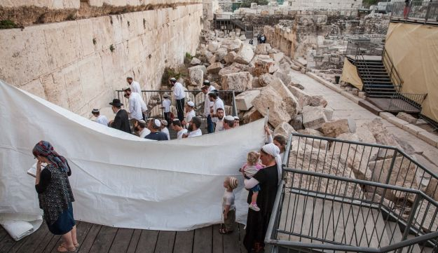 Orthodox Jews pray at the Robinson's Arch section of the Western Wall in a feared attempt to challenge the site's designation as a place for Reform and Conservative prayer, October 20, 2016.
