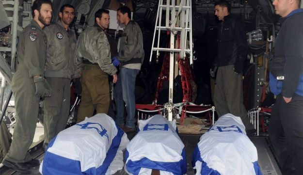 Israeli soldiers and medics load the bodies of three Israeli into a military plane at Ataturk Airport, in Istanbul, Sunday, March 20, 2016.