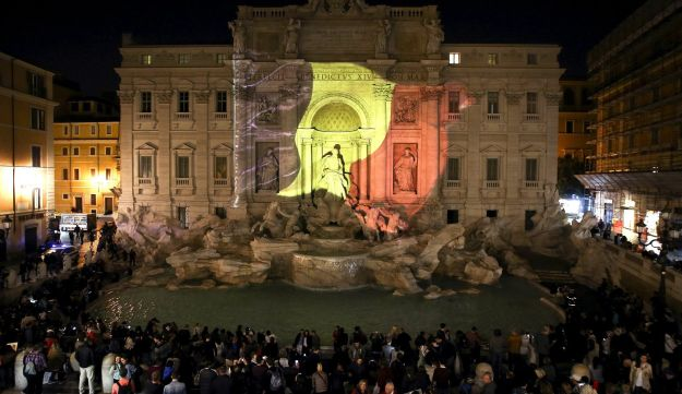 In tribute to the victims the black, yellow, and red colors of the Belgian flag are projected on the Trevi fountain, Rome, Italy, March 22, 2016.