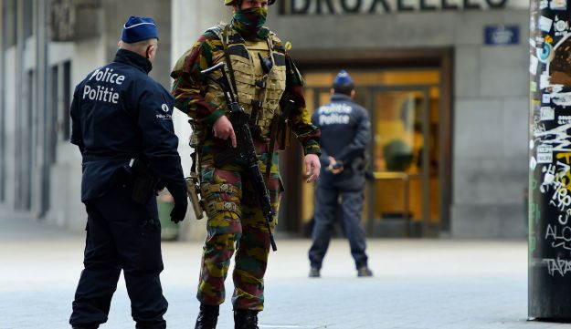 Belgian military personnel and police stand guard around the Central Station following coordinated attacks at the city's airport and metro system, Brussels, Belgium, March 22, 2016.