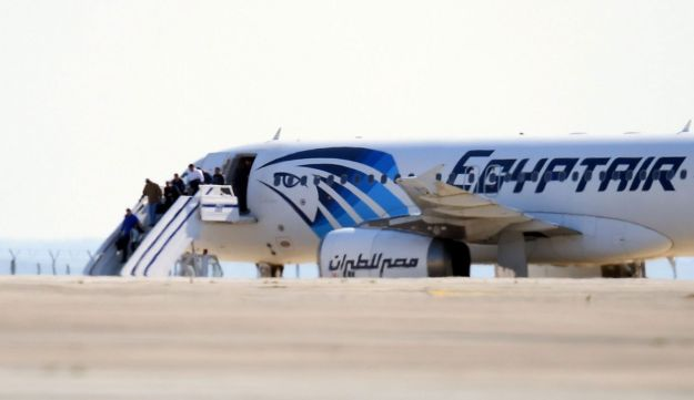 An EgyptAir plane, Airbus A320, Passengers disembark an Egypt Air Airbus A-320 sitting on the tarmac of Larnaca aiport after it was hijacked and diverted to Cyprus on March 29, 2016.