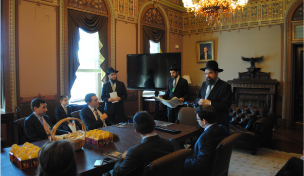 Matt Nosanchuk, seated at end of table, attending a Purim Megillah reading at the White House's Diplomatic Reception Room, March 24, 2016.