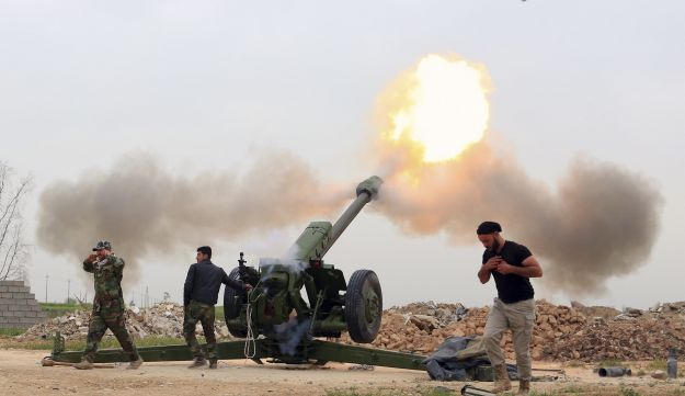 Iraqi forces fire at ISIS militants from villages south of the Mosul, Iraq, March 26, 2016.