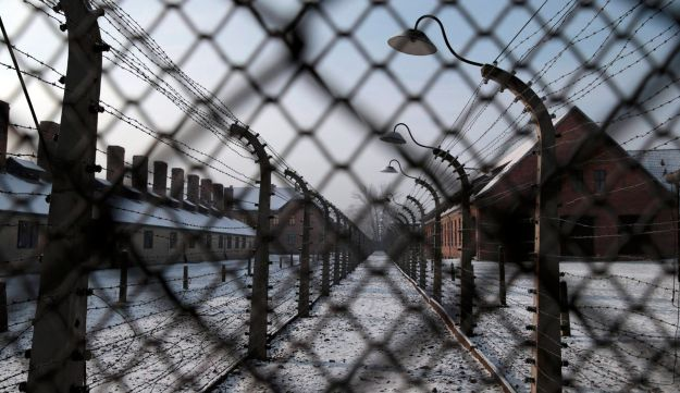 Former Auschwitz concentration camp pictured through a fence, January 27, 2014.