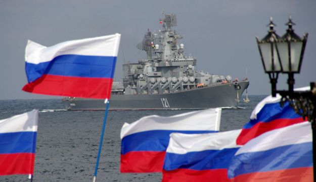 Pro-Russian supporters welcome a Russian missile cruiser in Crimea.