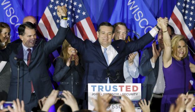 U.S. Republican presidential candidate Ted Cruz celebrates with his wife Heidi and Wisconsin Governor Scott Walker during Wisconsin primary night rally, Milwaukee, Wisconsin April 5, 2016.