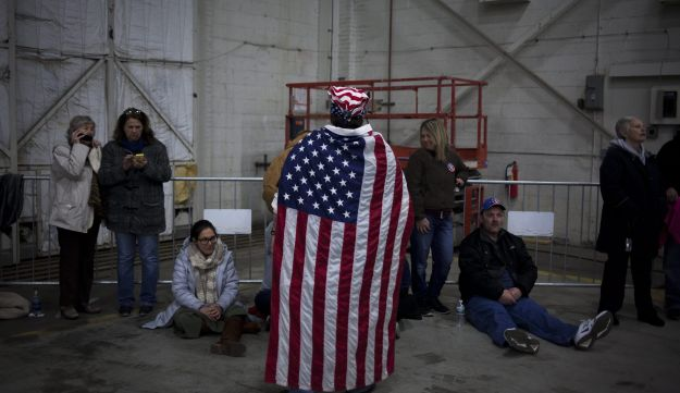 An attendee wears an American flag at a campaign event for Donald Trump in New York, U.S. April 6 2016.