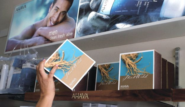 A woman reaches for an AHAVA Dead Sea cosmetic product manufactured in the Israeli Kibbutz settlement of Mitzpe Shalem, in the occupied West Bank.