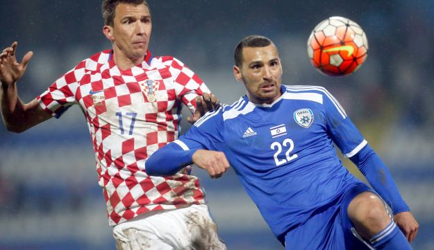 Croatian Jews are angry that fans chanted pro-Nazi slogans at an Israel-Croatia soccer match last month, pictured here where Israel's Shir Meir Tzedek, right, is challenged by Croatia's Mario Mandzukic.