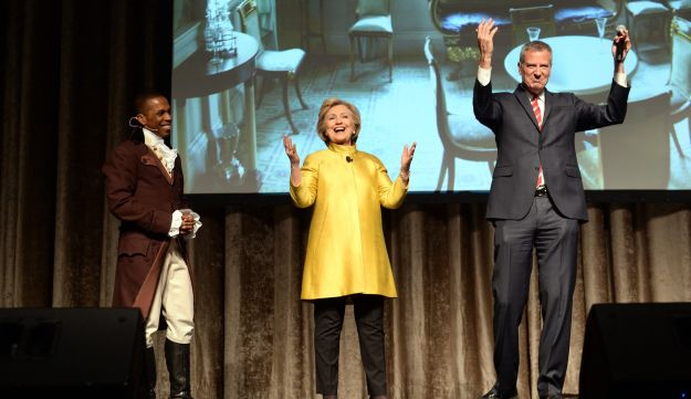 In this April 9, 2016 file photo, Leslie Odum Jr., left, presidential candidate Hillary Clinton, center, and New York City Mayor Bill de Blasio, right, perform in New York.
