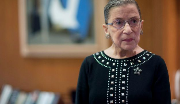 Ruth Bader Ginsburg, associate justice of the U.S. Supreme Court, stands in her chambers following an interview in Washington, D.C., U.S., on Friday, Aug. 23, 2013.
