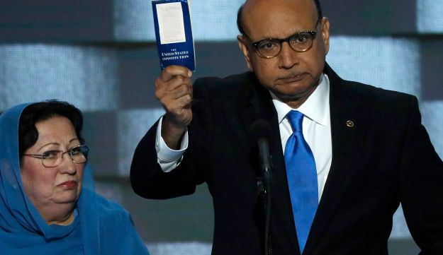 Khizr Khan, whose son died serving in the U.S. Army in the 10 years after the 9/11 attacks, speaks at the DNC in Philadelphia on July 28, 2016, accompanied by his wife, Ghazala Khan.
