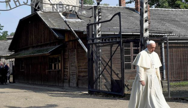 Pope Francis walks through the entrance of the former Nazi death camp of Auschwitz, Oswiecim, Poland, 29 July, 2016.