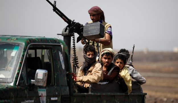 Houthi fighters ride on the back of a truck as they secure the site of a pro-Houthi tribal gathering in a rural area near Sanaa, Yemen on July 21, 2016.
