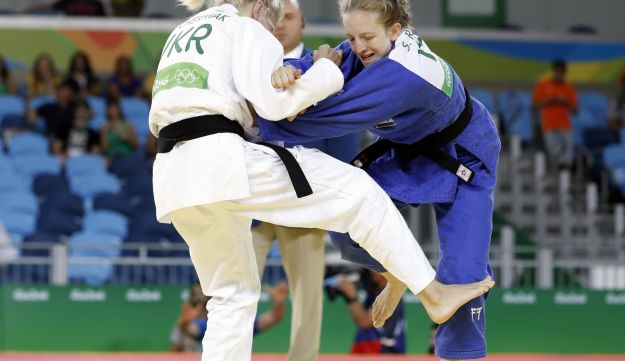 Ukraine's Maryna Cherniak (white) competes with Israel's Shira Rishony during their women's -48kg judo contest match of the Rio 2016 Olympic Games in Rio de Janeiro on August 6, 2016.