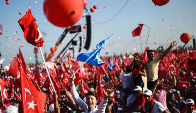 Demonstrators wave Turkish national flags during a rally against the failed military coup of July 15 in Istanbul, Turkey, August 7, 2016.