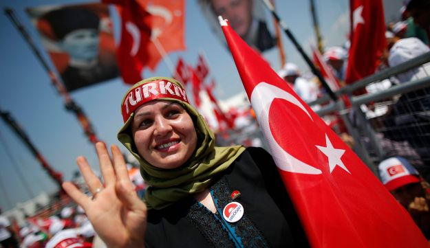 A Turkish woman waves during a rally against the failed military coup of July 15 in Istanbul, Turkey, August 7, 2016.