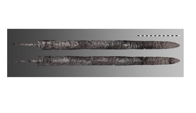 A sword found in side a house in ancient Ephesus, shown front and back.