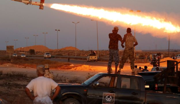 Fighters of Libyan forces allied with the UN-backed government fire a rocket at ISIS fighters in Sirte, Libya, August 4, 2016.