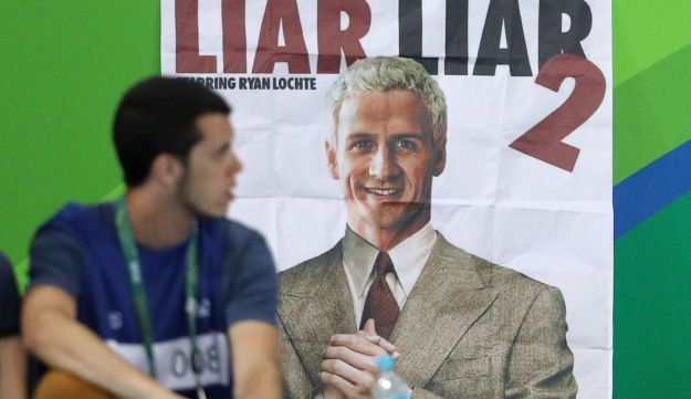 A poster showing a likeness of Ryan Lochte, an American Olympic swimmer, is seen at the stadium in Rio de Janeiro, Brazil, August 18, 2016.