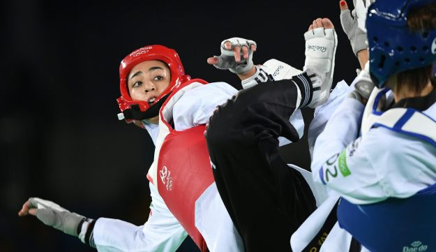 Iran's Kimia Alizadeh Zenoorin (L) competes against Spain's Eva Calvo Gomez during their women's taekwondo quarter-final bout in the -57kg category as part of the Rio 2016 Olympic Games, on August 18, 2016, at the Carioca Arena 3, in Rio de Janeiro.