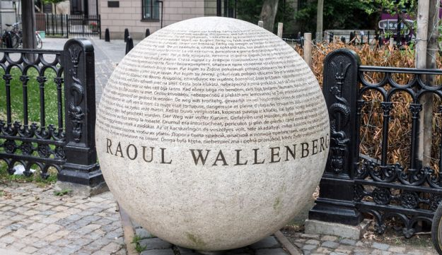 A large sphere with the name Raoul Wallenberg and names of people he saved in World War II on the Berzelii park in downtown Stockholm, Sweden.