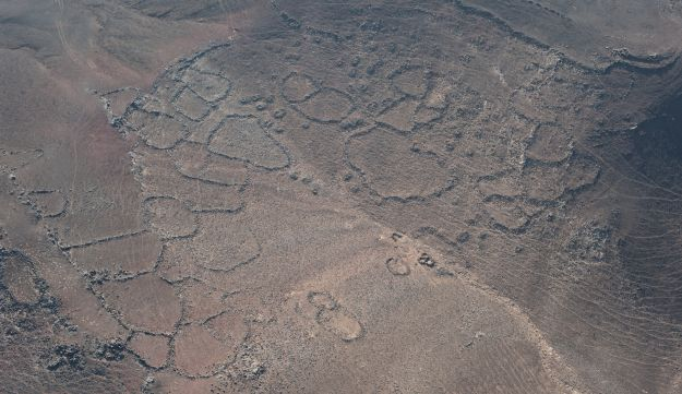 Aerial view of the garden terraces in the crater of the Tulul al-Ghusayn volcano.