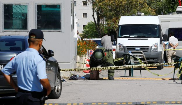 A bomb disposal expert examines a bag in front of the Israeli Embassy in Ankara, Turkey, September 21, 2016.