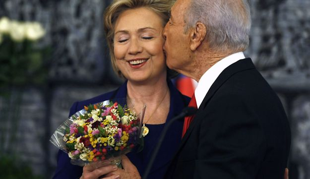 Then President Shimon Peres kisses then U.S. Secretary of State Hillary Clinton after their meeting in Jerusalem, Israel, March 3, 2009.