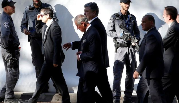 Britain's Prince Charles, center, is seen upon his arrival to Mount Herzl Cemetery to attend the funeral of former President Shimon Peres, in Jerusalem September 30, 2016.
