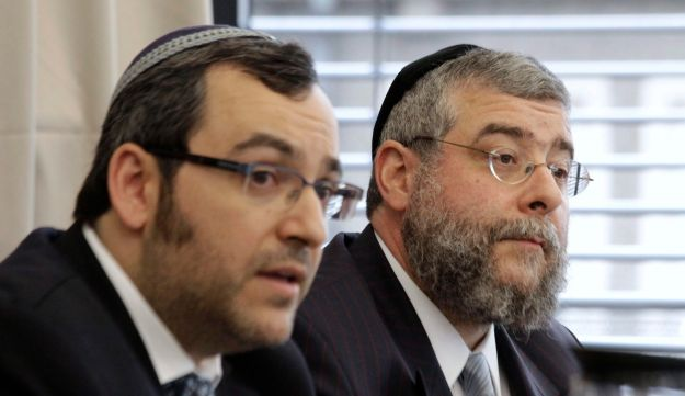 Rabbi Pinchas Goldschmidt (right) and Rabbi Avichai Apel address a news conference after a meeting in Berlin, Germany, July 12, 2012.