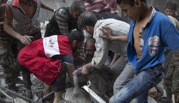 A man cries over the body of his child after she was pulled out from the rubble of a building following airstrikes in the rebel-held neighborhood of Al-Shaar in Aleppo, Syira, September 27, 2016.