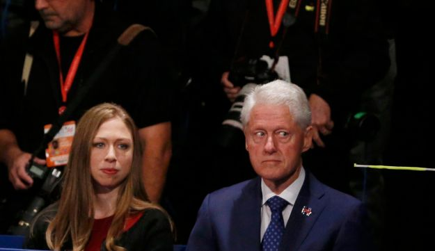 Marc Mezvinsky, Chelsea Clinton and Former U.S. President Bill Clinton sit at the presidential town hall in St. Louis, Missouri on October 9, 2016.