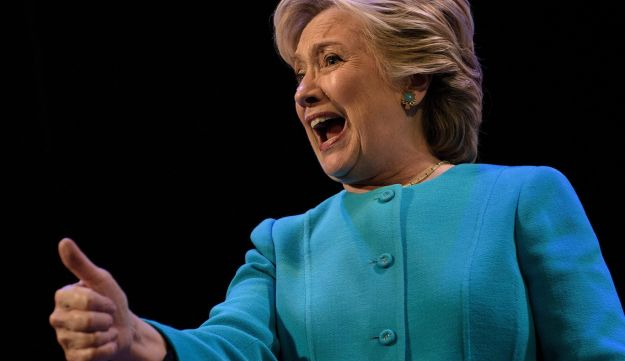 U.S. Democratic presidential nominee Hillary Clinton gives a thumbs up after speaking at fundraiser at the Paramount Theater in Seattle, Washington, October 14, 2016.