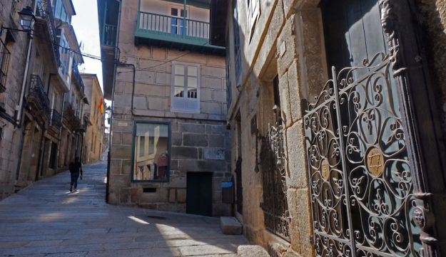 A tourist walking past the old synagogue in Ribadavia, Sept. 24, 2016.