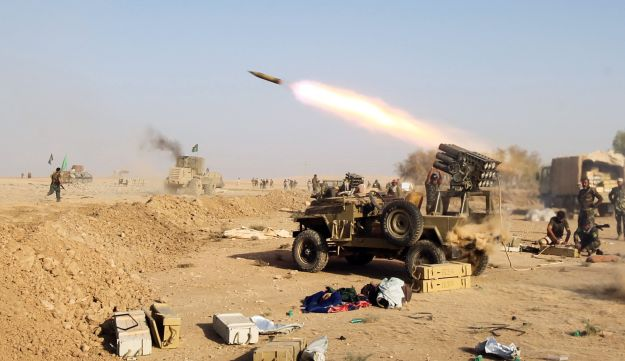 Shi'ite fighters from the Popular Mobilization Forces launches missiles on the village of Salmani, south of Mosul, October 30, 2016
