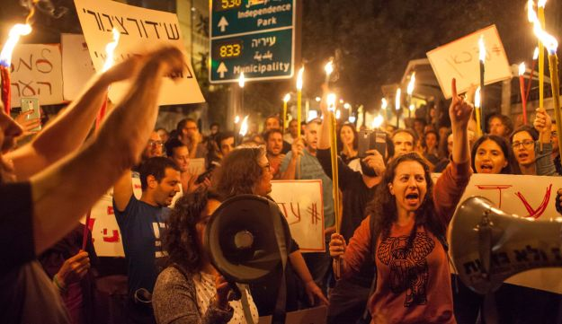 Demonstrators outside the Prime Minister's residence in Jerusalem gather to support the public broadcasting entity that Netanyahu wants to quash.