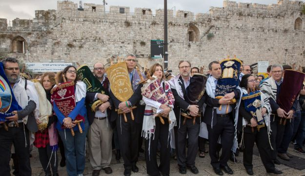 Israeli members of the liberal Jewish religious group Women of the Wall, carry a Torah scroll after prayers in the women's section of the Western Wall, in the Old city of Jerusalem on November 2, 2016.