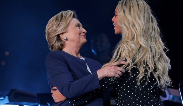 U.S. Democratic presidential nominee Hillary Clinton is joined by artist Beyonce at a campaign concert in Cleveland, Ohio, U.S. November 4, 2016.